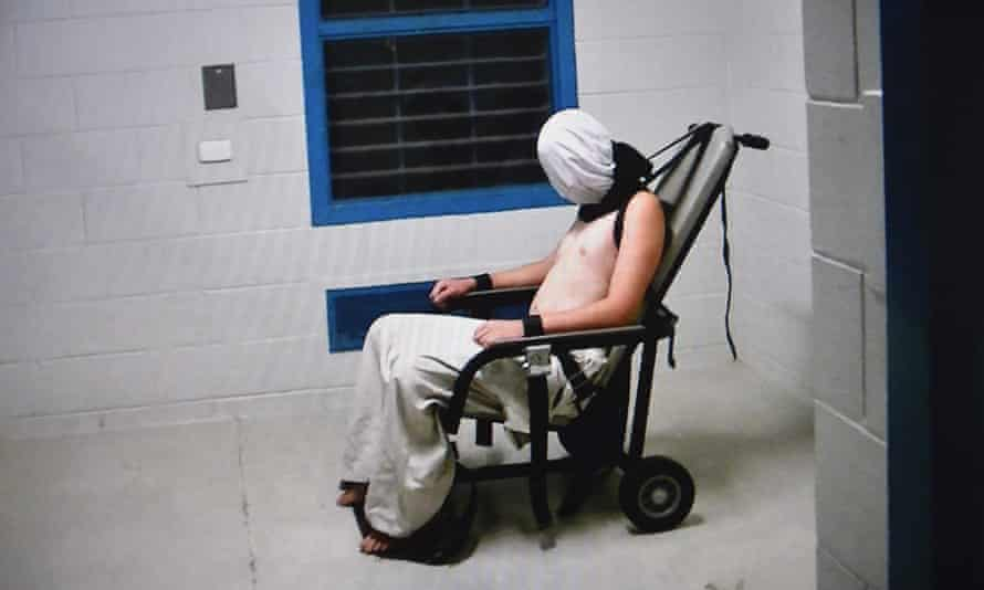 Dylan Voller hooded and strapped into a chair at Don Dale a youth detention centre in Darwin, as shown by Four Corners