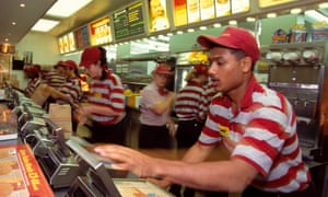 Staff serve customers at the McDonald's branch in Brent Cross, London