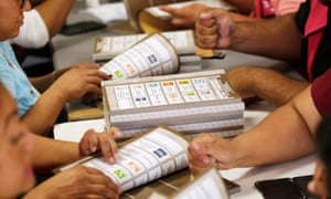 Employees of the National Electoral Institute (INE) count ballots at a warehouse where materials for the upcoming election are stored.