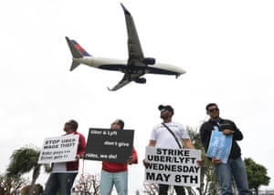 Rideshare drivers for Uber and Lyft stage a strike and protest at the LAX International Airport, over what they say are unfair wages in Los Angeles, California on 8 May 2019.