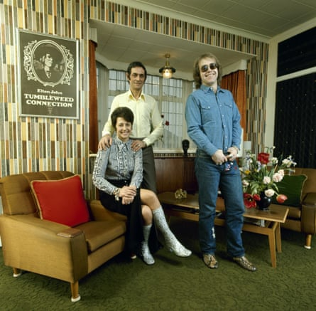 'I came back from the States with American critics calling me the saviour of rock 'n' roll': John with his mother Sheila and stepfather Fred Fairebrother at their apartment, London 1971.