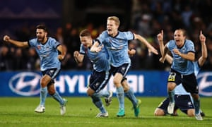 Sydney FC players celebrate after Milos Ninkovic scores the winning penalty during the 2017 A-League grand final.