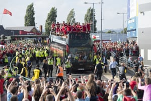 An open top bus carrying the Wales team arrives at the Cardiff City Stadium on July 8, 2016 in Cardiff, Wales.