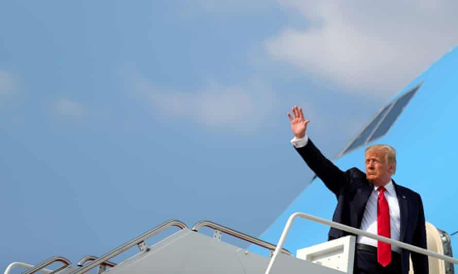 Donald Trump waves as he boards Air Force One to travel to South Dakota.