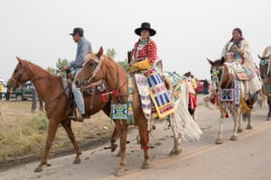 JoRee LaFrance rides in the parade during the 100th Annual Crow Fair Celebration Powwow and Rodeo in Crow Agency, Mont. on Sunday, August 19, 2018.