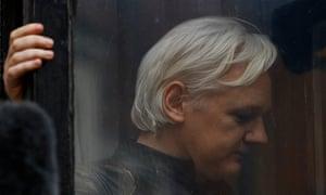 Julian Assange is seen on the balcony of the Ecuadorian embassy in London.
