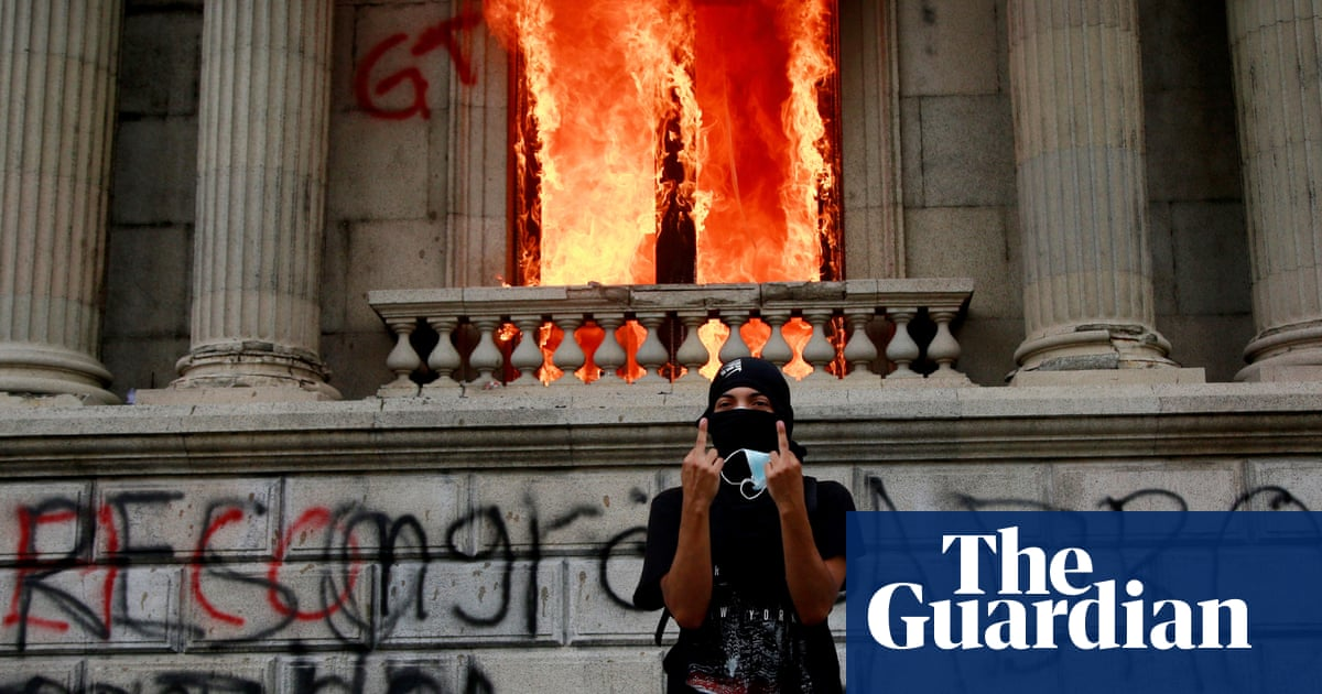 Guatemala protesters set congress on fire during budget protests – The Guardian
