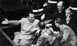 Hermann Goering, left, speaks to Baldur von Schirach in the dock at the Nuremberg trial.