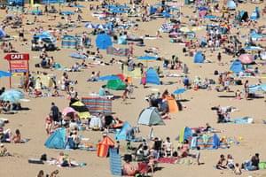 Broadstairs, England Sunbathers enjoy the warm weather in Kent