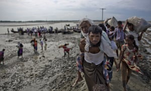 A group of Rohingya people cross the border into Bangladesh after fleeing violence in Myanmar