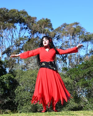 A woman dances on a hilltop in Kate Bush-inspired attire.