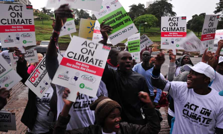 People take part in demonstration calling for climate change justice for Africa in Nairobi