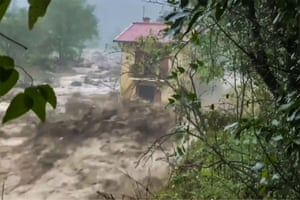 A video grab shows a house shortly before it was washed away in Roquebillière