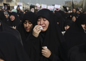 A women weeps during a demonstration in Tehran