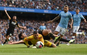 Raúl Jiménez lands on the back of Manchester City goalkeeper Ederson after the goalkeeper made a save at the Etihad Stadium. Wolves beat Manchester City away from home in a top-flight match for the first time since December 1979, having drawn once and lost six there since then before today.