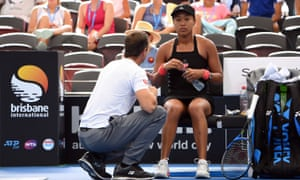 Japan's Naomi Osaka talks to her coach during the women's quarter-final match against Anastasija Sevastova.