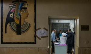 Electoral workers count ballots in Cairo at the end of the final day of the Egyptian presidential election.