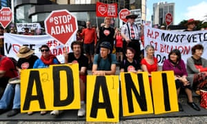 Protesters rally outside Adani's headquarters in Brisbane over its proposed Carmichael coal mine.