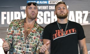 Tyson Fury (left) wore a suit featuring images of old-time bare-knuckle boxing champions at his final press conference alongside Saturday's opponent Tom Schwarz.