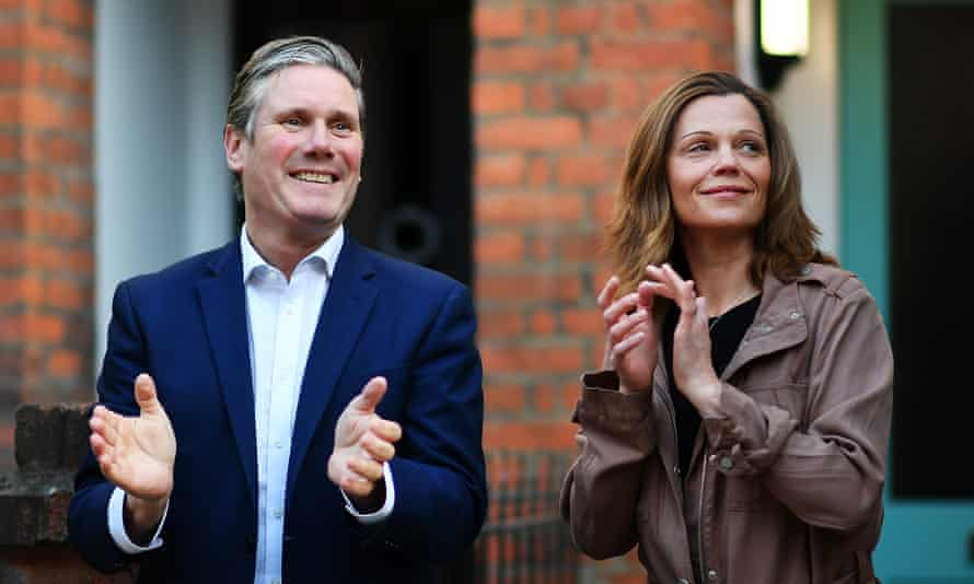 Keir Starmer and his wife Victoria applaud NHS and key workers outside their home in May.