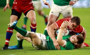 Garry Ringrose of Ireland, tackled by Kirill Gotovtsev of Russia.
