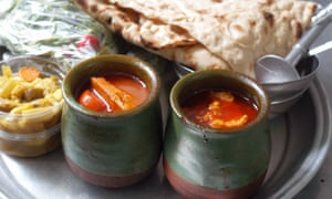 Traditional dizi stew in 2 pots with flatbread