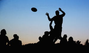 silhouette of rugby players taking a lineout