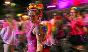 Participants dance during the 40th anniversary of the Sydney Gay and Lesbian Mardi Gras Parade in central Sydney, Australia March 3, 2018.