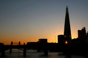London, England: The rising sun shines through a window of the Shard