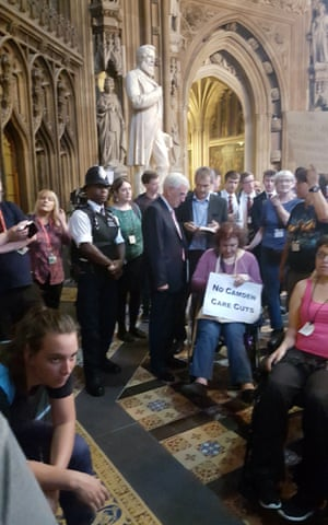 John McDonnell (centre) talking with a group of protesters in wheelchairs who blocked the MPs' entrance to the House of Commons chamber to demonstrate over cuts to benefits.