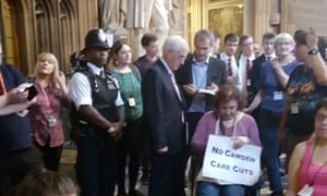 John McDonnell (centre) greets the Disabled People Against Cuts protesters at Westminster