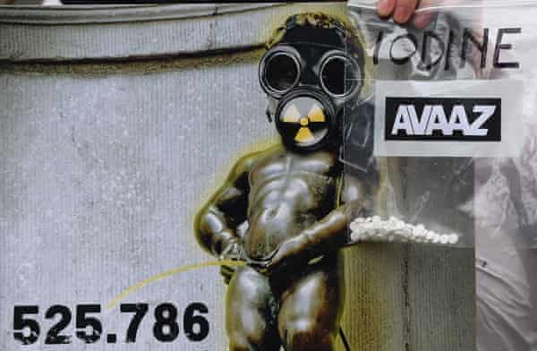 Brussel's landmark bronze sculpture Manneken Pis is pictured with a gas mask on a banner.