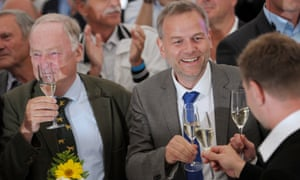 Leif-Erik Holm and Alexander Gauland of AfD react after exit polls in Mecklenburg-Vorpommern