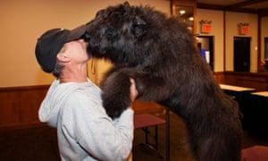 A dog greets his handler at Hotel Pennsylvania