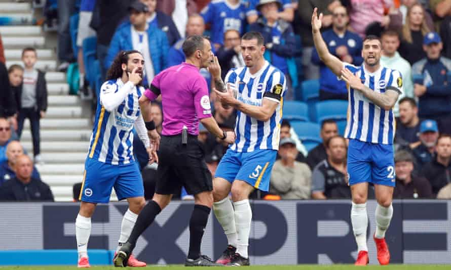 Brighton players appeal to Stuart Attwell for a penalty against Leicester