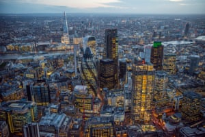 Dusk aerial view across the Square Mile / City of London . Three huge new skyscrapers, 22 Bishopsgate, The Scalpel and 100 Bishopsgate are currently under construction in the City and will again change the skyline of London enormously