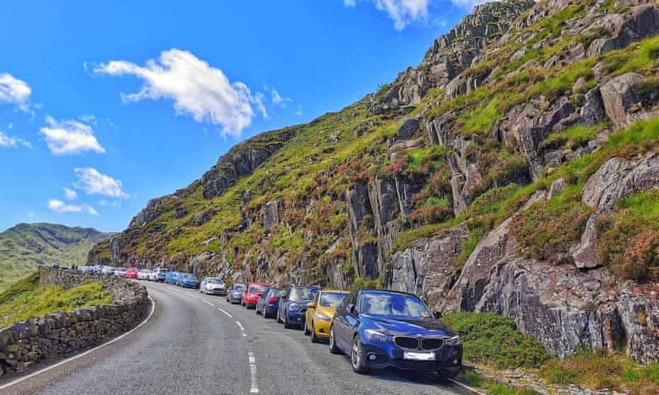 Cars parked illegally on the clearway near Pen-y-Pass, Snowdonia, in the summer.