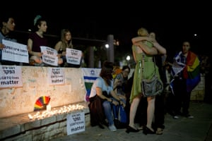 Tel Aviv, Israel. Members of the LGBT community members light candles in solidarity with the dead