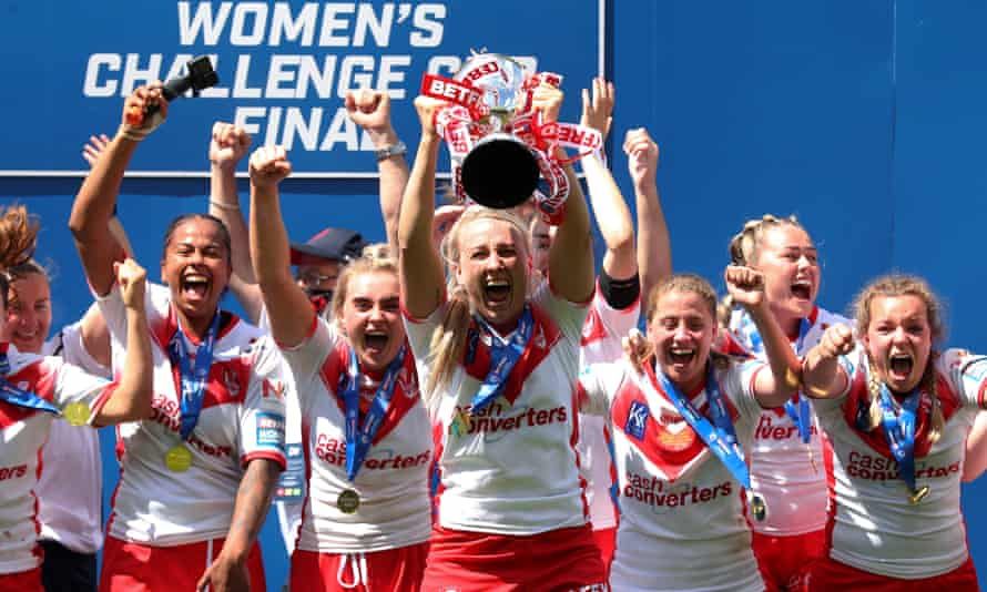 Jodie Cunningham of St Helens lifts the Women's Challenge Cup trophy