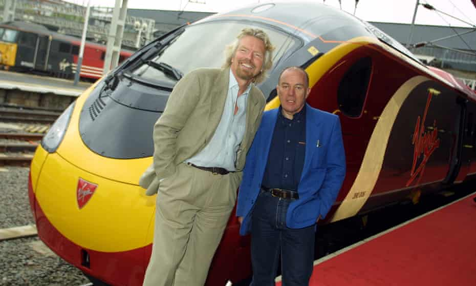 Souter, right, with Richard Branson at the launch of the high-speed Pendolino train in 2002.