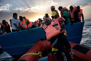 A child is rescued from a vessel in the Mediterranean, north of Libya, on 3 October