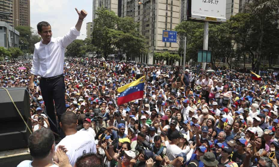 Opposition leader Juan Guaidó flashes a thumbs up at supporters during a rally in Caracas on Wednesday.
