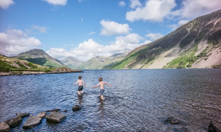 Wild swimming boys in Wast Water the deepest and coldest of all the lakes.