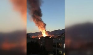 The Tehran clinic burns in footage obtained from the state-run Iran Press news agency.