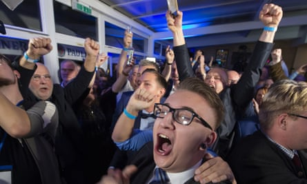 Supporters of the far-right AfD celebrate after the first results of local elections in Erfurt, Germany, in October 2019