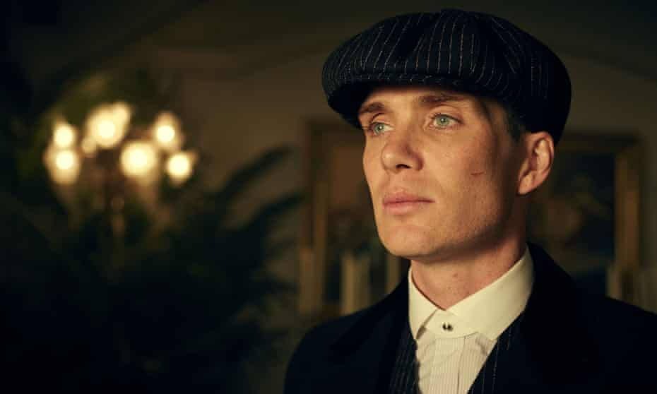 Actor Cillian Murphy as Thomas Shelby from Peaky Blinders wearing his trademark cap.