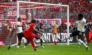 Bayern Munich's Renato Sanches scores their third goal.