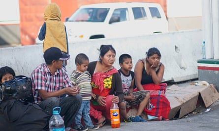 Migrants wait at a border crossing in Tijuana, Mexico, on 12 September.