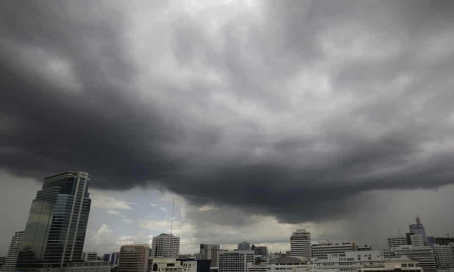 Dark clouds gather above the skyline in Bangkok, Thailand