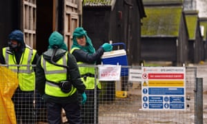People in protective clothing at a farm affected by bird flu in Nafferton, November 2014. Defra's disease prevention funding is likely to be protected but other areas could be forced to manage cuts of up to 80%.
